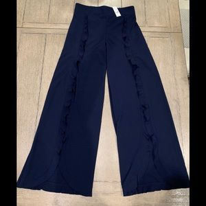 New with tags. Navy blue ruffled palazzo pants.